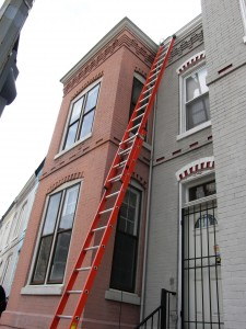 ladder against a row house