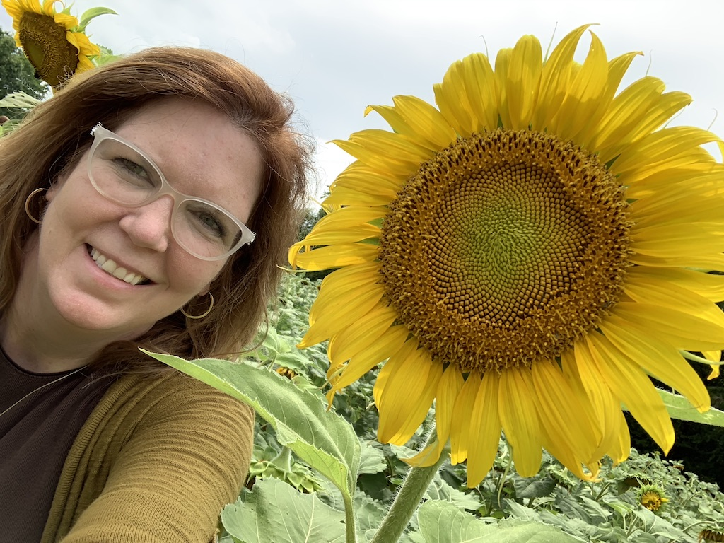 Dana Hollish Hill with a sunflower